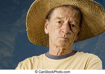 Man in a Big Straw Hat - Senior man in a straw hat in front...
