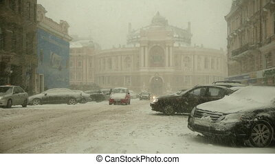 Winter city - Snow falling in Odessa, Ukraine near Opera...