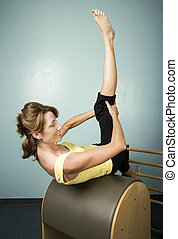 Woman Exercising - Athletic Woman Exercising and Stretching...