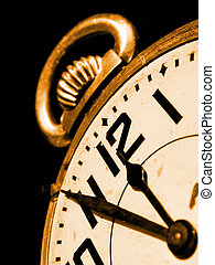 Old antique pocket watch on brown background