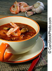 Tomato soup with seafood. - ?up of tomato soup on a wooden...