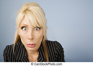 Apprehensive woman - Close Up of an Apprehensive blonde...