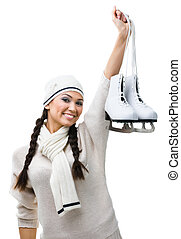Smiling female figure skater hands skates - Female figure...