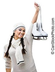 Smiling female figure skater hands skates - Female figure...