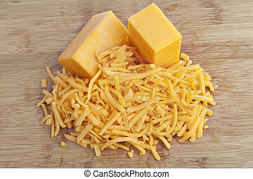 180 cheddar cheese - Shredded cheddar cheese on a brown...