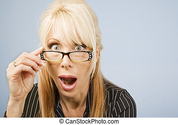 Woman Looking Over Her Glasses - Businesswoman looking over...