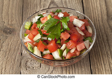 a bowl with salsa mexicana - Close-up image of a bowl with...