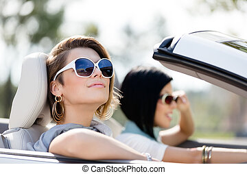 Close up of girls in sunglasses in the white car - Close up...