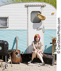 Girl Sitting on a Trailer Step - Punk girl with brightly...