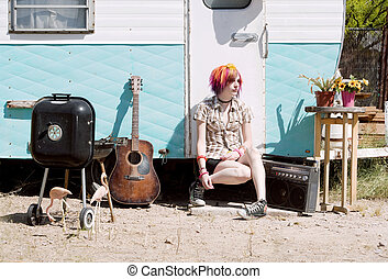Girl Sitting on a Trailer Step