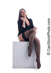 young  woman sitting in sexy lingerie on cube