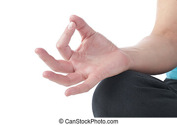 close up of hands of a woman doing yoga meditation