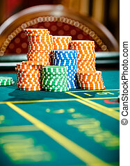 Close up view of piles of chips on the roulette table