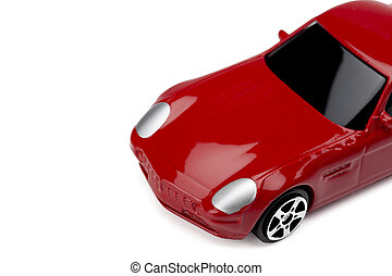 cropped image of red sport car toy