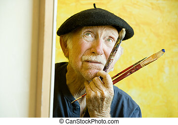 Artist with a Beret at a Canvas looking up - Elderly painter...