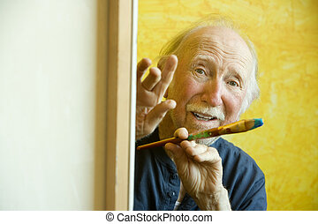 Artist at a Canvas - Elderly painter working on a large...