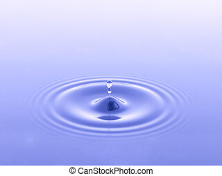 falling raindrops on blue water - Image of falling raindrops...