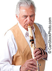 Elderly senior male playing native american flute - Senior...