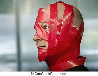 Red Tape - Businessman wrapped in red tape