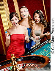 Three women playing roulette