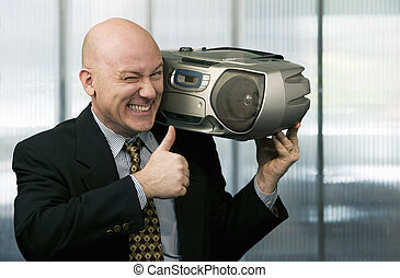 Businessman with Boom Box - Bald businessman listening to a...