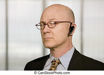 Businessman with a hands-free phone - Portrait of...