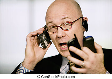 Businessman with multiple cell phones