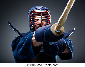 Close up of kendoka training with shinai Concept of Asian...