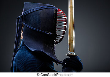 Profile of kendo fighter with shinai Japanese martial art of...