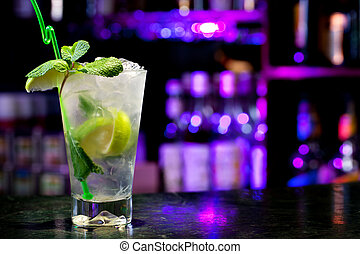 Mojito cocktail on the background of the bar