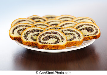 Slices of poppy seed rolls on plate