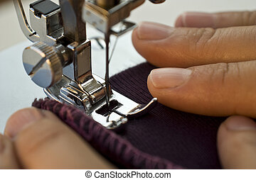 Sewing machine - Close-up of a sewing machine foot with...