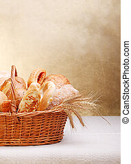 Assortment of bakery products on basket Copy space above