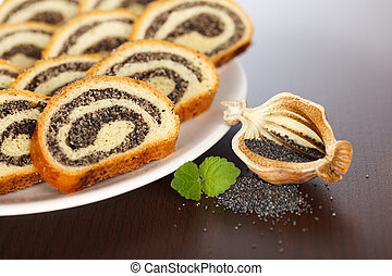 Macro of Poppy seed roll slices and half pod