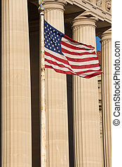 American Flag and Columns of Government Building