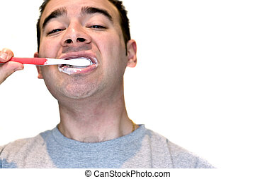 Man Brushing His Teeth - A closeup of a young man while he...