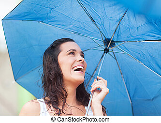 happy beautiful woman under umbrella