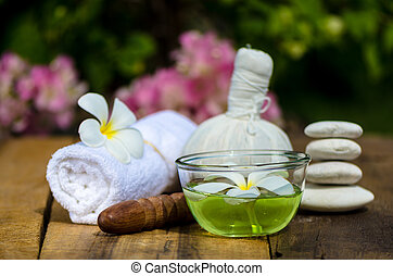 Spa massage setting with thai herbal compress stamps and...