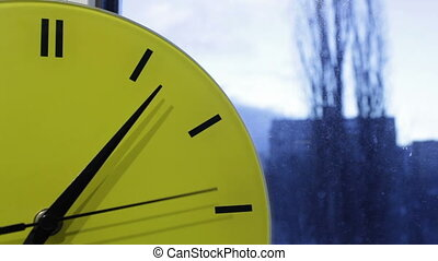 Yellow clock. Time lapse.