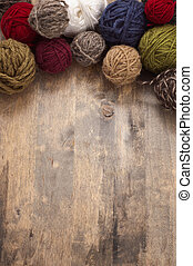 woolen balls on wooden background