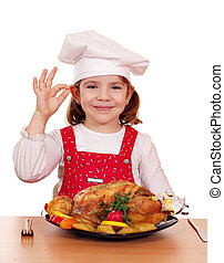beautiful little girl cook with grilled chicken