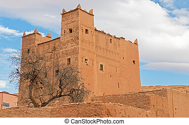 Morocco Kasbah over blue sky and clouds