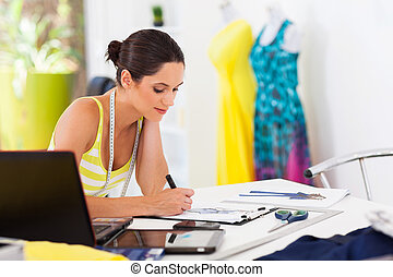 fashion designer drawing - pretty female fashion designer...