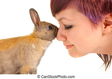 Rabbit hug - Lovely teenager girl hugging a little newborn...