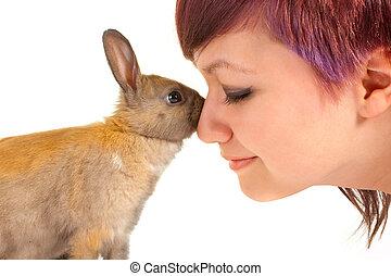 Rabbit hug - Lovely teenager girl hugging a little newborn...