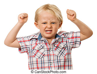 Angry young boy - A frustrated and angry young boy with...