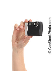 Beautiful woman hands holding a black compact camera