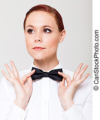 young woman holding bow tie - elegant young woman holding...