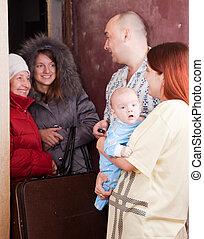Family of three is meeting a kinsfolk at home Focus on baby...