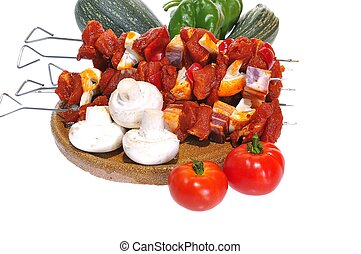 Pork kebabs - Isolated pork kebabs with a white background